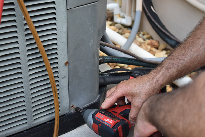 Outdoor AC unit repair in Boca Raton.
