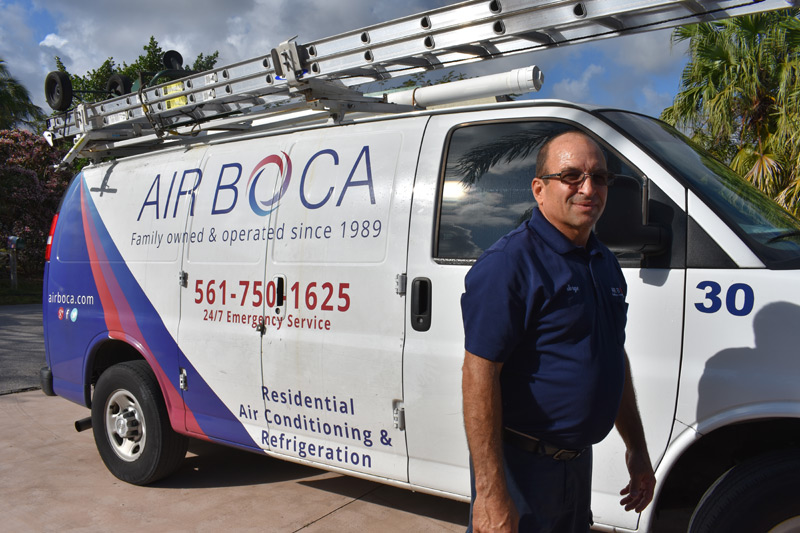 air boca employee standing in front of van